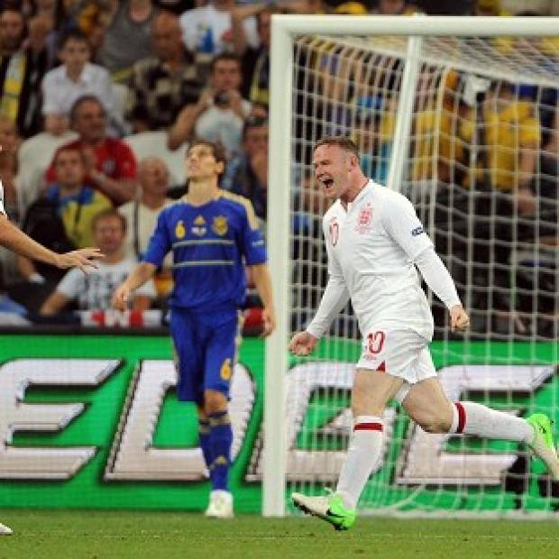 Wayne Rooney's (right) second-half winner set up a quarter-final clash against Italy