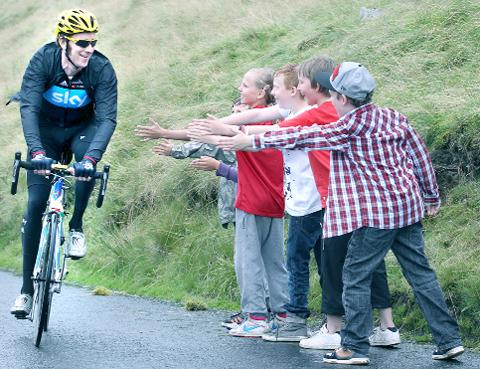Young fans greet Bradley Wiggins on yesterday's route.
