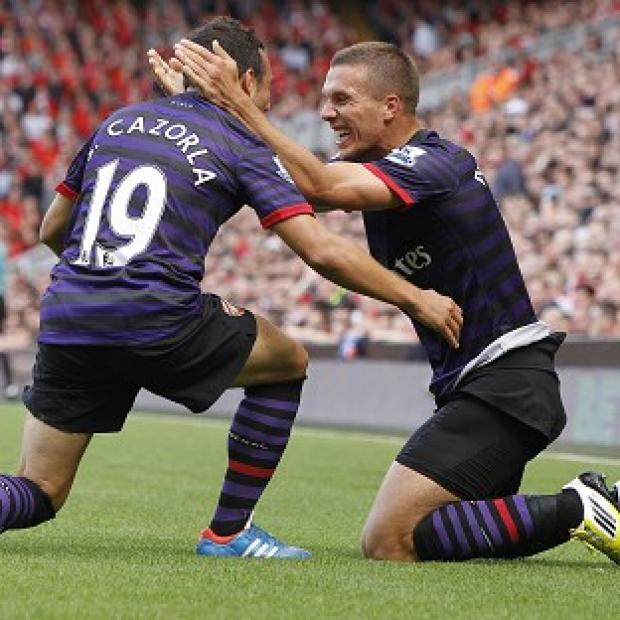 Lukas Podolski, right, celebrates his first Arsenal goal with Santi Cazorla, who also netted