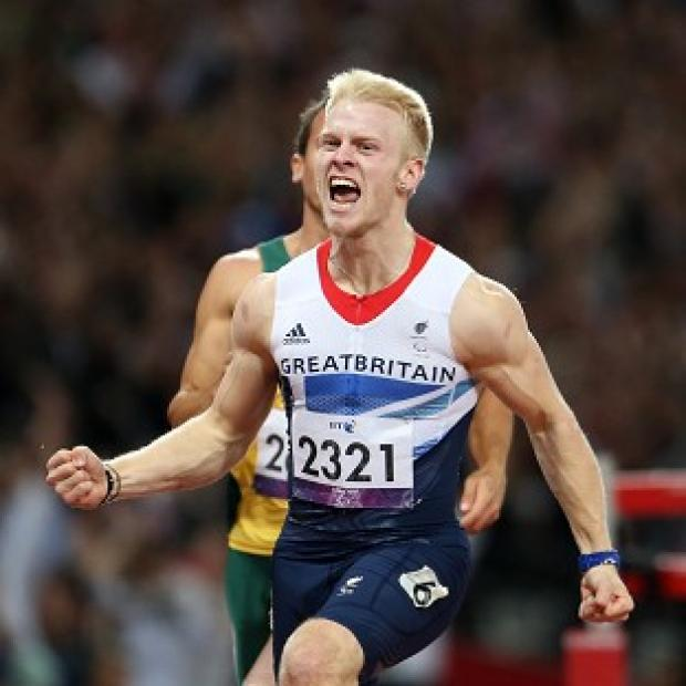 Jonnie Peacock broke the Paralympic record as he claimed gold