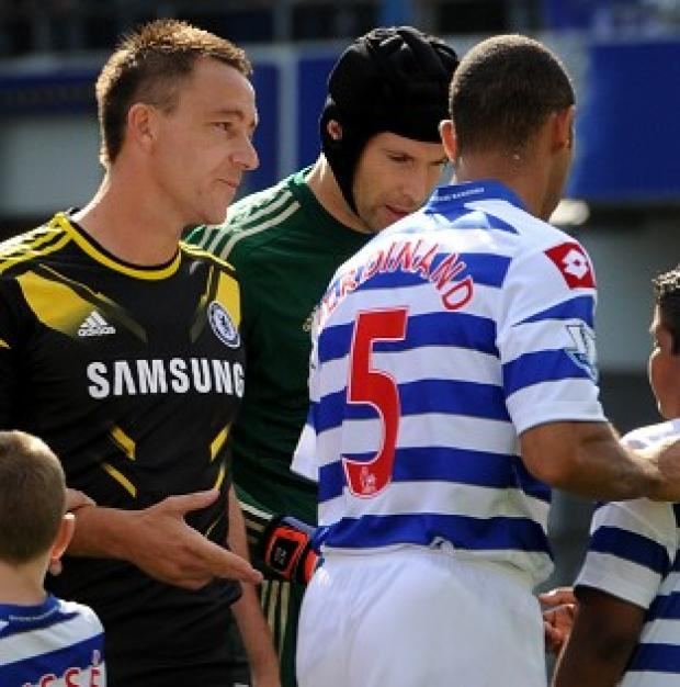Anton Ferdinand, shirt number 5, snubs John Terry, left