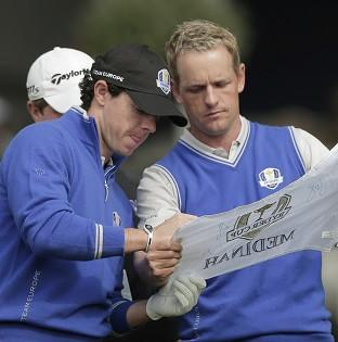Rory McIlroy, left, is focussing on the whole team at the Ryder Cup (AP)