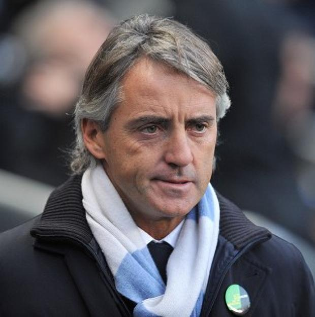 Roberto Mancini admitted his intention was always to remain in England with Manchester City
