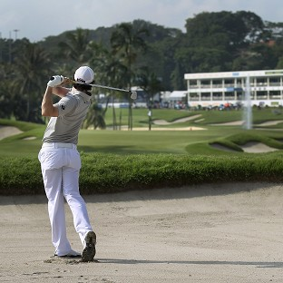 Rory McIlroy fired a closing 65 to climb the leaderboard on the final day of the Singapore Open (AP)