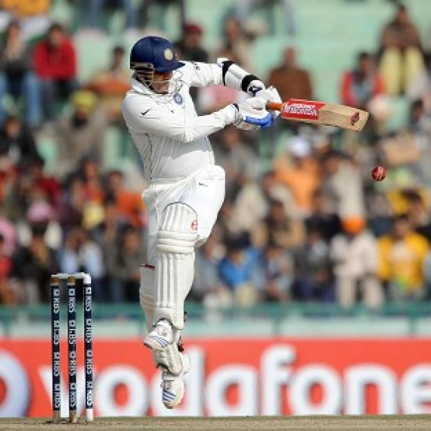 Virender Sehwag, pictured, hit a majestic 117 before being bowled by Graeme Swann