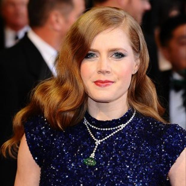 Amy Adams had to work on her pitching skills for her new film