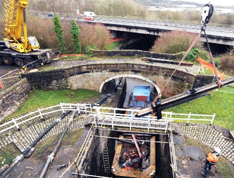 HEAVY DUTY Workers from British Waterways fit new lock gates and arms on the canal beneath Colne Road in Barrowford