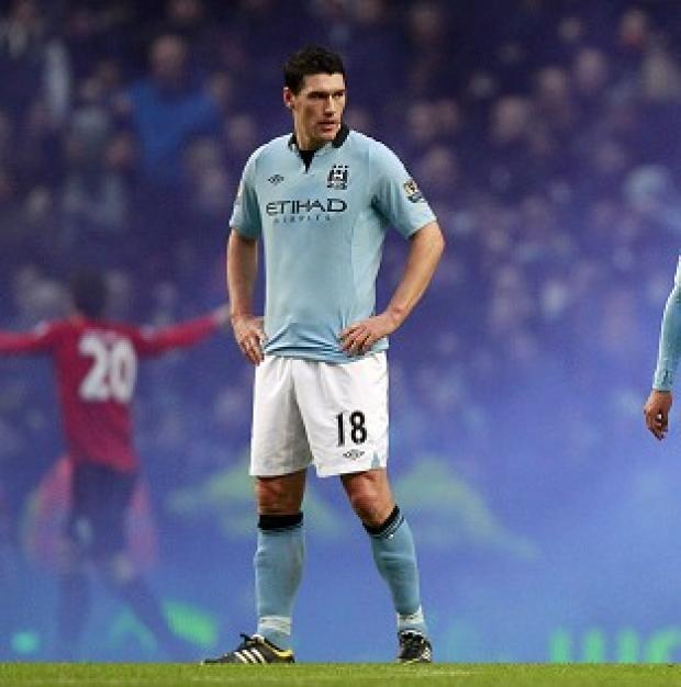 Burnley and Pendle Citizen: The FA have charged Gareth Barry for using abusive and/or insulting words towards a match official in the Manchester derby