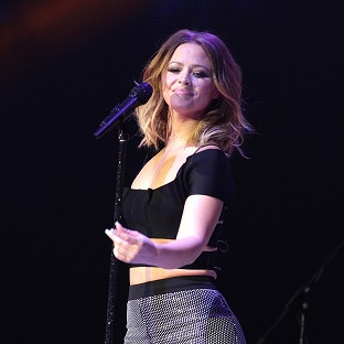 Kimberley Walsh says Girls Aloud have fallen back into their own roles since getting back together