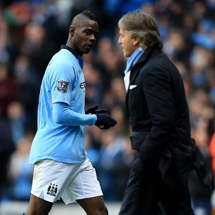 Mario Balotelli, left, and Roberto Mancini, right, have reportedly had a training ground bust-up