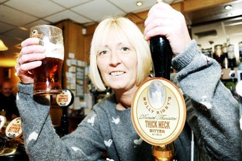 GOOD GOLLY MISS MOLLY Landlady at Molly Rigby's bar Tracey Leonard raises a pint of Thick Neck