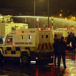 Burnley and Pendle Citizen: Police use water cannon in Belfast to disperse loyalists in the ongoing Union flag protests