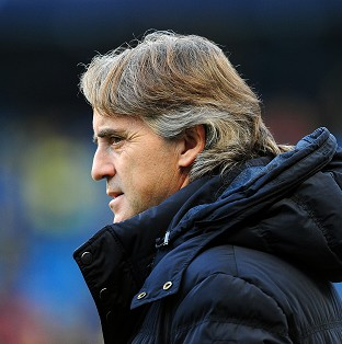 Roberto Mancini believes Manchester City can recover after falling seven points behind Manchester United