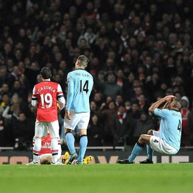 Vincent Kompany, right, reacted with disbelief following his dismissal against Arsenal