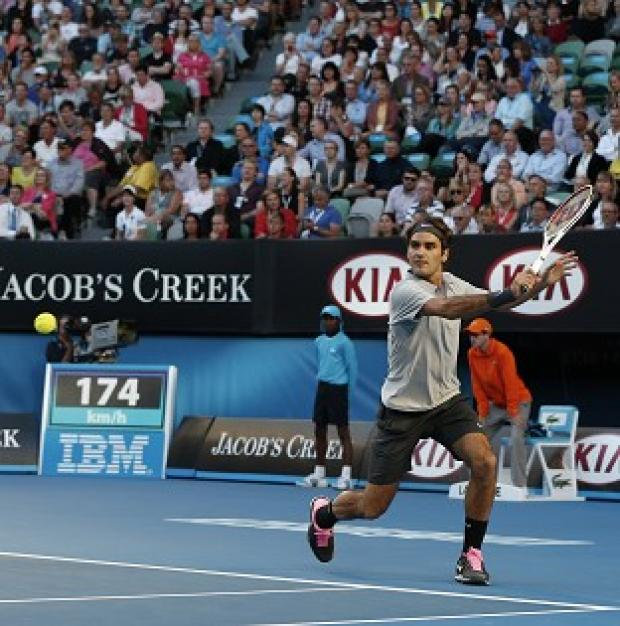 Roger Federer, pictured, defeated Bernard Tomic in straight sets