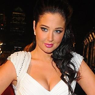 X Factor judge Tulisa Contostavlos arrives for the 2013 National Television Awards at the O2 Arena