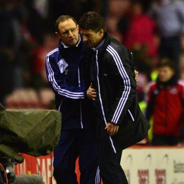 Martin O'Neill, left, and Michael Laudrup saw their sides share the spoils