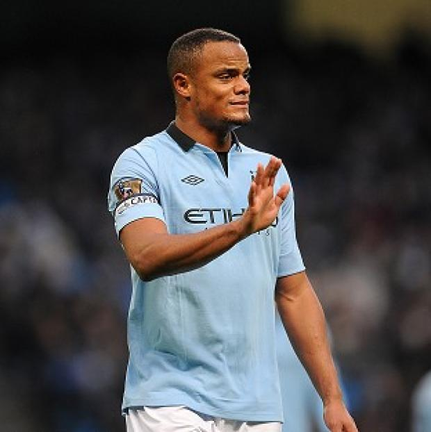 Vincent Kompany could be sidelined for three more weeks with a calf strain