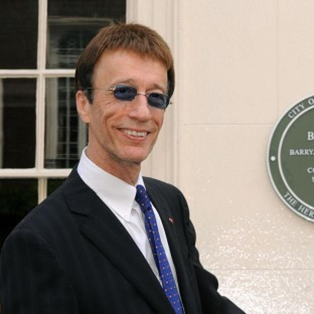 Robin Gibb's widow said the singer would have been delighted to have become a grandfather