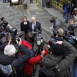 Broadcaster Stuart Hall talks to the media outside Preston Magistrates' Court