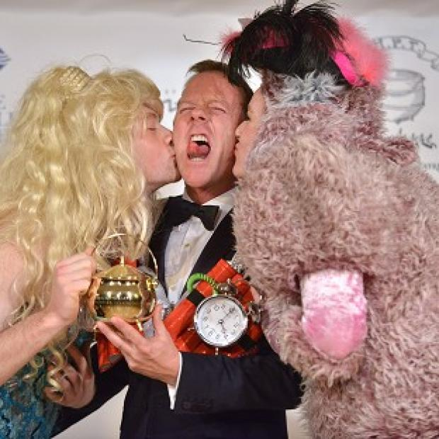 Kiefer Sutherland is honored as the Hasty Pudding Man of the Year (AP)