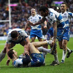 Tim Visser celebrates a try during Scotland's impressive win over Italy