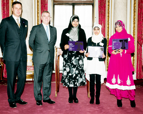 Dragon's Den's Peter Jones, the Duke of York, stall helpers Irham Sajid and Aneesa Riaz, and Ameena Bibi at Buckingham Palace where Ameena received the Tycoon in Schools Award for her bespoke candles