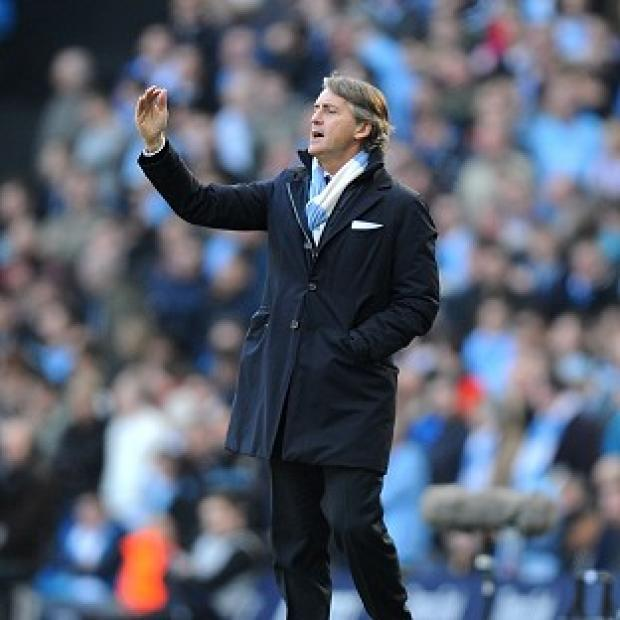 Manchester City boss Roberto Mancini, pictured, reserved special praise for two-goal man Sergio Aguero