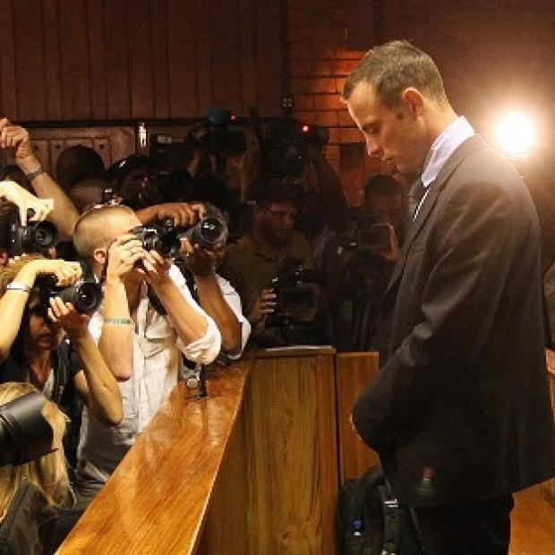 Oscar Pistorius stands in the dock during his bail hearing in Pretoria (AP)