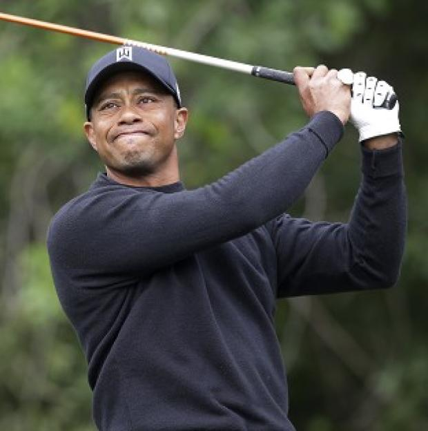 Tiger Woods watches his shot off the third tee during the third round of the Honda Classic (AP)