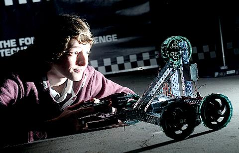 Ryan Hamer, 14, of Read, with a robotic car