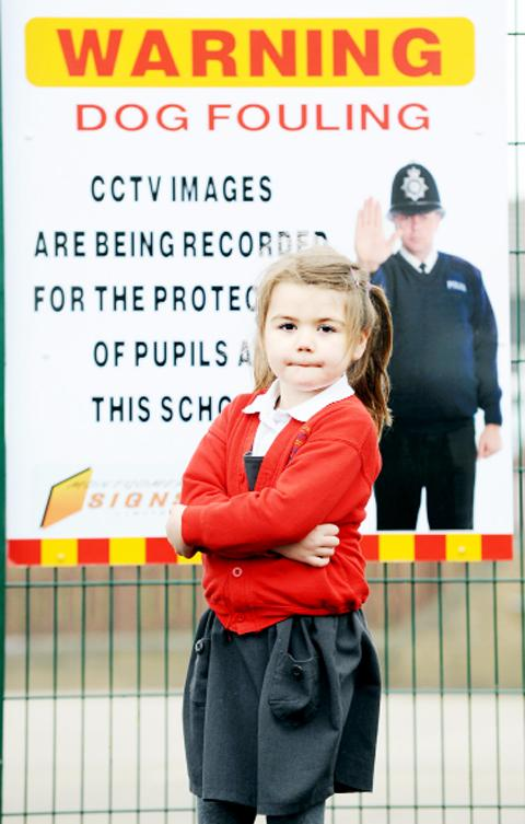Sacred Heart pupil Evie Woods by the poster that hopes to make dog owners more responsible for their pets