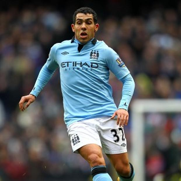 Carlos Tevez is available to take his place in the Manchester City side to take on Barnsley