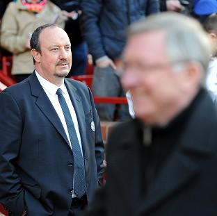 Rafael Benitez, left, was waiting to shake hands with Sir Alex Ferguson before Sunday's FA Cup quarter-final