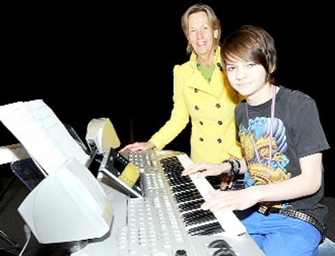 Electronic Keyboard class winner Harvey Whybrow-Parker, 13, from Clayton-le-Moors, with adjudicator Deborah Brittain
