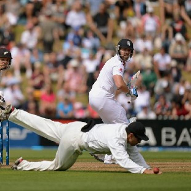 England's Matt Prior bats as New Zealand's Bradley-John Watling (left) watches Ross Taylor (centre) dive to stop the ball