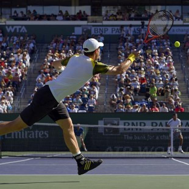 Andy Murray returns a shot to Juan Martin del Potro during their match at the BNP Paribas Open in Indian Wells (AP)