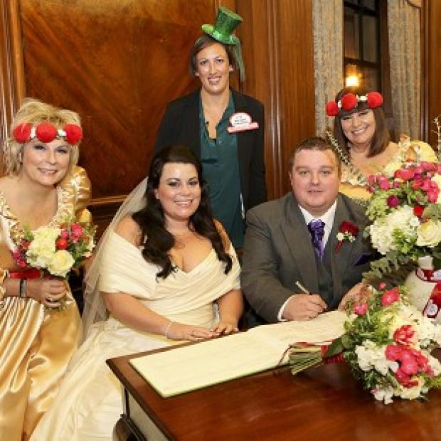 Bride Claire Gilchrist and groom Ben Springett at their wedding planned by Miranda Hart, flanked by Dawn French and Jennifer Saunders