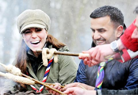GETTING ALONG FAMOUSLY: Abid Saleh helps out along with Kate Middleton.