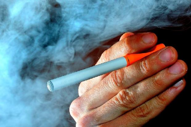 Burnley and Pendle Citizen: A person smokes an electronic cigarette, or e-cigarette.