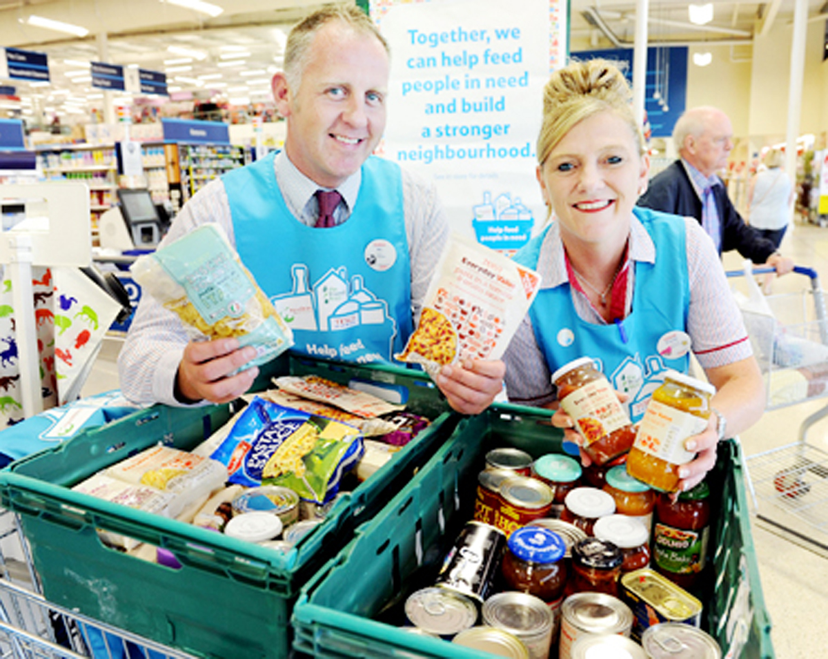 Tesco staff Richard Cross and Tracey Gleave collect for Fair Share in Burnley