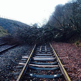 Road and rail travellers faced more misery as storms continue to batter Britain