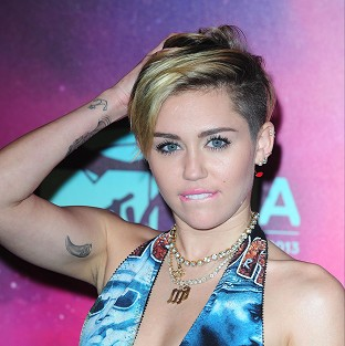 Miley Cyrus insists she loves Beyonce just as much as everyone else