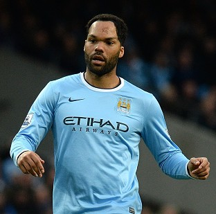 Manuel Pellegrini believes Joleon Lescott, pictured, still has a role to play for Man City