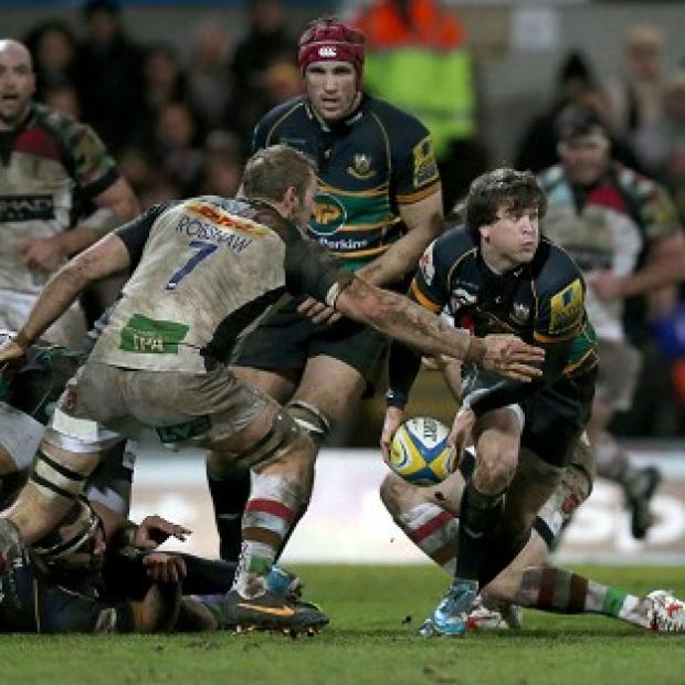 Burnley and Pendle Citizen: Lee Dickson is tackled by Harlequins' Chris Robshaw at Franklin's Gardens