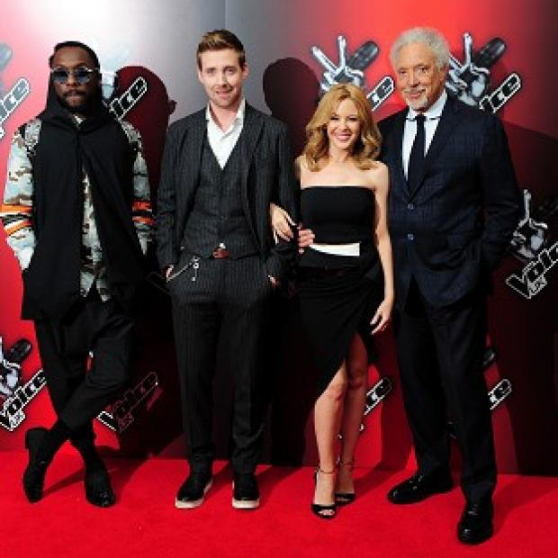 Burnley and Pendle Citizen: At the launch of BBC talent show The Voice are coahces (from left) Will.i.am, Ricky Wilson, Kylie Minogue and Sir Tom Jones