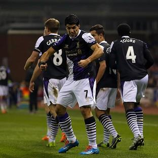 Luis Suarez, centre, scored twice in Liverpool's win