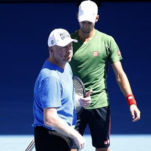 Novak Djokovic, right, of Serbia talks with former Grand Slam champion and coach Boris Becker of Germany during a training session ahead of the Australian Open tennis championship in Melbourne, Au