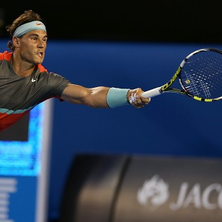 Rafael Nadal progressed to the second round of the Australian Open, taking the first set against Bernard Tomic before the home favourite retired