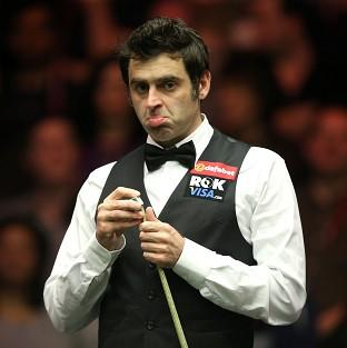 Ronnie O'Sullivan, pictured, moved into the second round by comfortably beating Robert